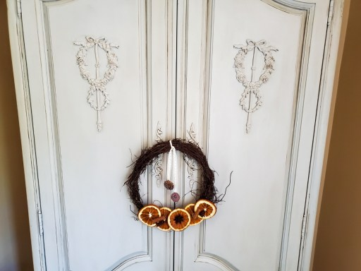 close up of French armoire doors and a wreath