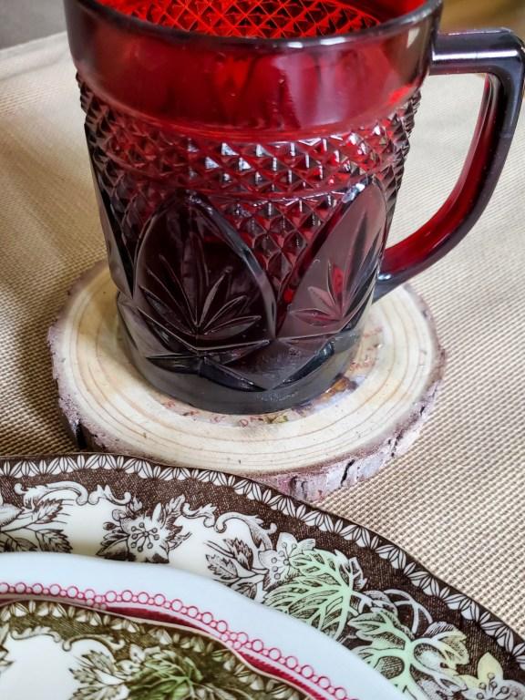 Red mug sitting on the DIY wood coasters