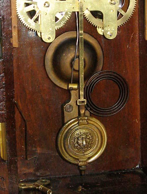 Pendulum bob and gong.