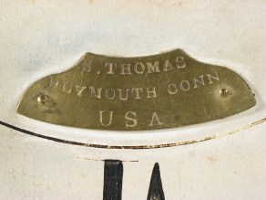 The brass nameplate on on the dial. S. THOMAS PLYMOUTH CONN U S A