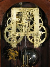 Gilbert 8 day time and strike movement. Note the stopworks gears (the star-like gears) on the winding arbors.