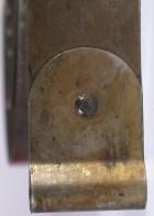 Barnes patented mainspring 0.020 inch thick (from Gilbert walnut shelf clock, strike side)