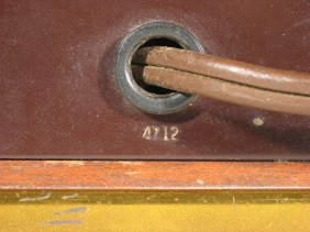 Date code 4712 on the metal rear cover beneath the power cord.