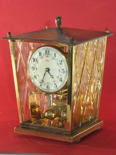 Kundo miniature 400 day clock, 8 1/ 4inches tall.