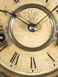 "The Waterbury logo. Says ""Waterbury Clock Co."" at the bottom"