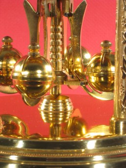 Note the ridges on the tops of the pendulum balls. Most pendulum balls are smooth.