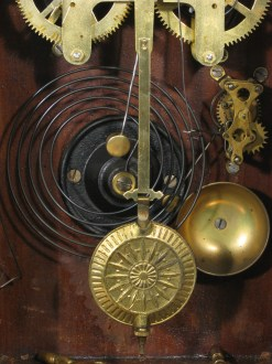 Showing the pendulum, gong and and the alarm unit.