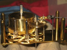 Side view of gears showing the auxiliary mainspring barrel (center).