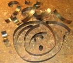 The broken time mainspring - 22 pieces!