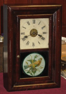 "Seth Thomas ""Round Band"" with original bird picture on lower glass."