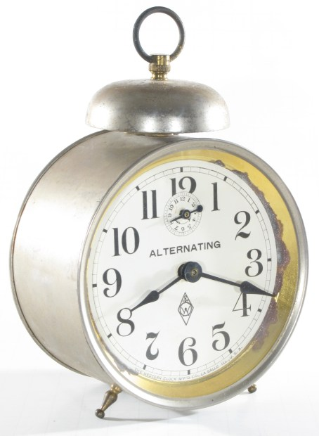 Alternating alarm clock dated 8-17-07 (August 17, 1907) on the movement