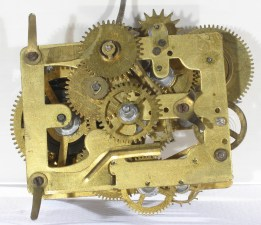 "Front of Alternating movement. The brass repeat spring is fastened by the lower left pillar screw and extends to the right. The 3rd wheel cam raises the spring's middle bent down end. Its bent down right end stops the ""hammer lock"" on the alarm hammer."