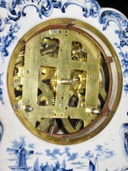 """The china case is """"sandwiched"""" between the metal mounting ring and the wooden movememnt mounting board."""