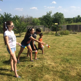 Playing with the kids in our yard