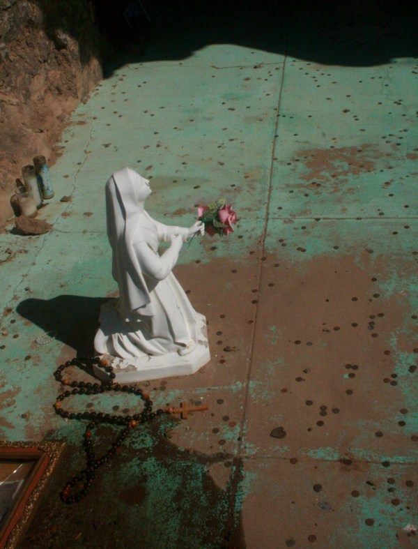 Madonna and rosary in shrine on cross mound by San Xavier del bac mission
