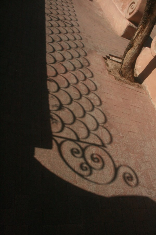 Cast shadow of ironwork at San Xavier del bac mission