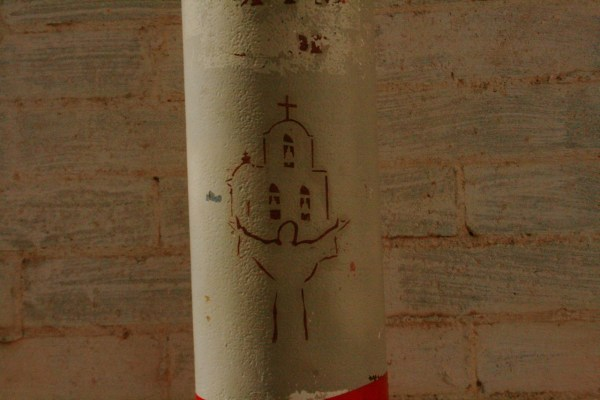 Painting on a large pipe at San Xavier del bac mission