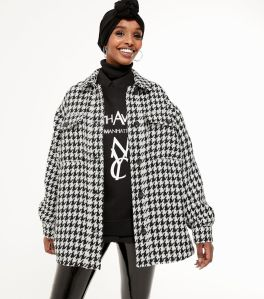 Woman in houndstooth jacket