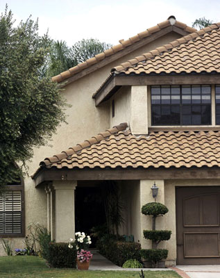 House with a hip roof style and clay shingles
