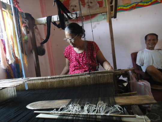 a weaving artisan with her husband