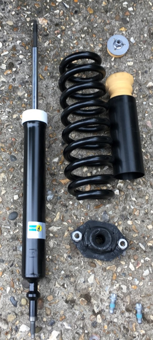 New shock, spring, shock top, top mount, lower mount and bolts