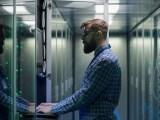 man-typing-datacenter