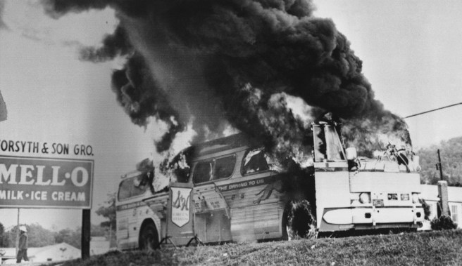A Freedom Rider bus went up in flames in May 1961 when a fire bomb was tossed through a window near Anniston, Ala. The Freedom Riders escaped without serious injury. (AP file)