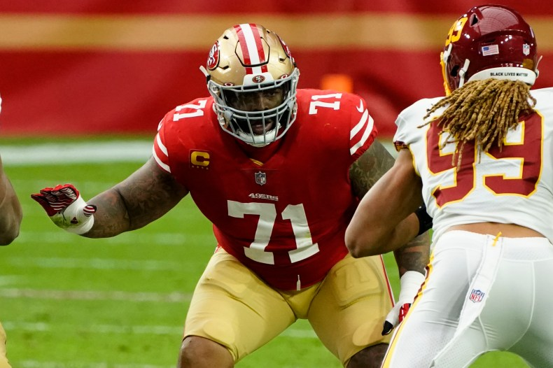 Trent Williams (left) signed a six-year, $138 million deal with the 49ers this offseason as tackles continue to cash in.