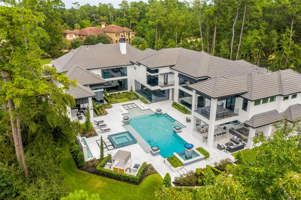 newly built mansion in the woodlands