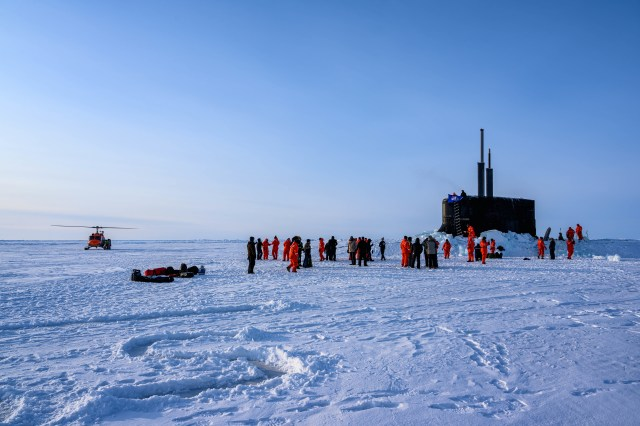 The crew of the U.S. Navy's Seawolf-class submarine Connecticut enjoys ice liberty after surfacing in the Arctic Circle during Ice Exercise 2020 on March 7, 2020. ICEX is a biennial submarine exercise that promotes interoperability between allies and partners to maintain operational readiness and regional stability, while improving capabilities to operate in the Arctic environment. (MC1 Michael B. Zingaro/U.S. Navy)