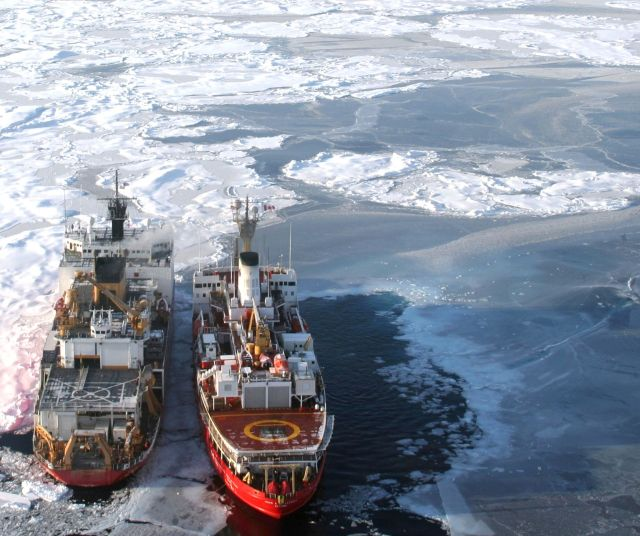 Canadian Coast Guard ship Louis S. St. Laurent alongside U.S. Coast Guard cutter Healy in the Arctic Ocean helped map the Arctic seafloor and gather data to help define the outer limits of the continental shelf in the region. (Jessica Robertson/U.S. Geological Survey)