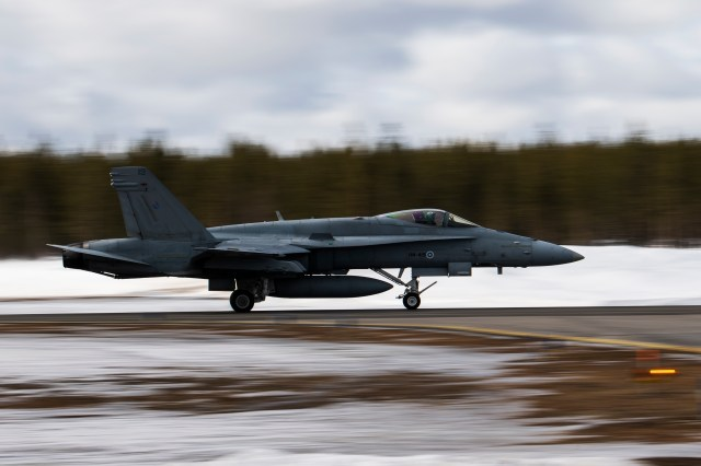 A Finnish F-18 Hornet departs from Jokkmokk Air Base during a joint exercise between the air forces of Finland and Sweden over the Arctic Circle towns of Jokkmokk in Sweden and Rovaniemi in Finland on March 25, 2019. (Jonathan Nackstrand/AFP via Getty Images)