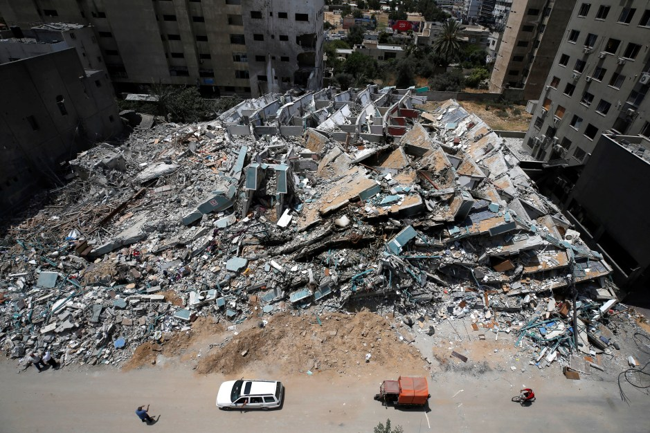 A view shows the remains of a tower building destroyed by Israeli missile strikes in the recent cross-border violence between Palestinian militants and Israel, following Israel-Hamas truce, in Gaza City May 21, 2021. REUTERS/Mohammed Salem