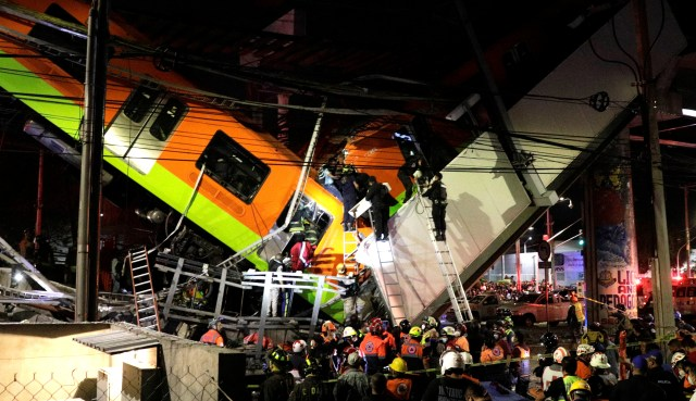 Rescuers work at a site where an overpass for a metro partially collapsed with train cars on it at Olivos station in Mexico City, Mexico May 03, 2021. REUTERS/ Luis Cortes