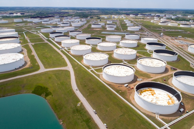 Crude oil storage tanks are seen in an aerial photograph at the Cushing oil hub in Cushing, Oklahoma, U.S. April 21, 2020. REUTERS/Drone Base