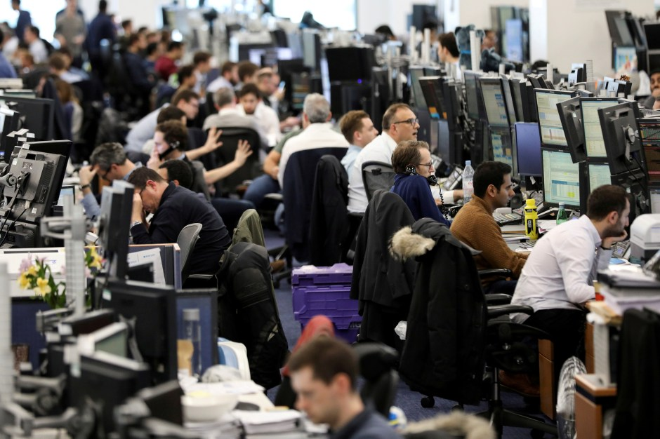 Traders work on the trading floor of Barclays Bank at Canary Wharf in London, Britain December 7, 2018. REUTERS/Simon Dawson/File Photo