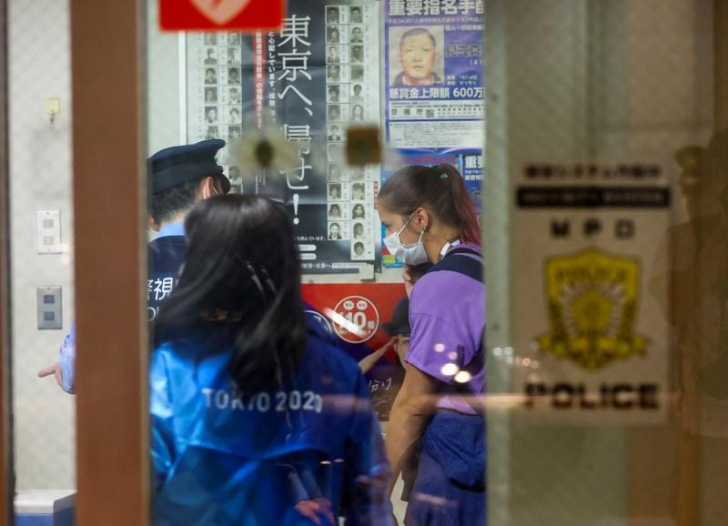 Belarusian athlete Krystsina Tsimanouskaya is seen inside a police box at Haneda international airport in Tokyo, Japan August 1, 2021.  REUTERS/Issei Kato