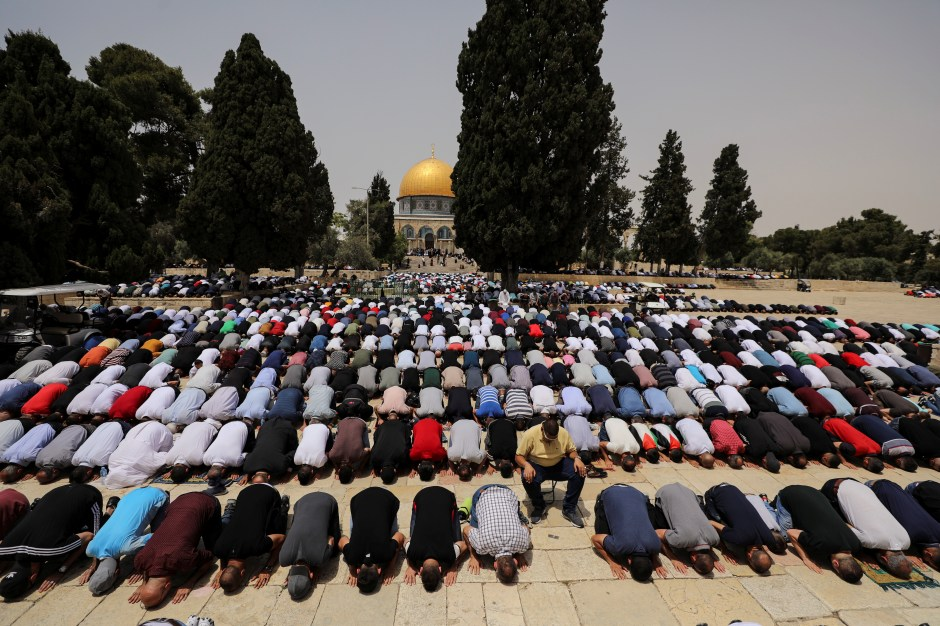 Palestinians pray at the compound that houses Al-Aqsa Mosque, known to Muslims as Noble Sanctuary and to Jews as Temple Mount, in Jerusalem's Old City May 21, 2021. REUTERS/Ammar Awad