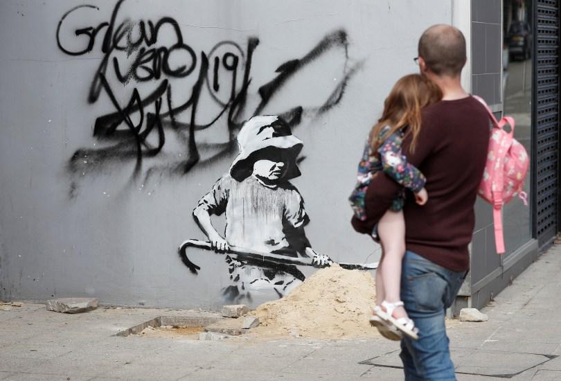 Artwork created by Banksy is seen in Lowestoft, Britain, August 8, 2021. REUTERS/Peter Nicholls