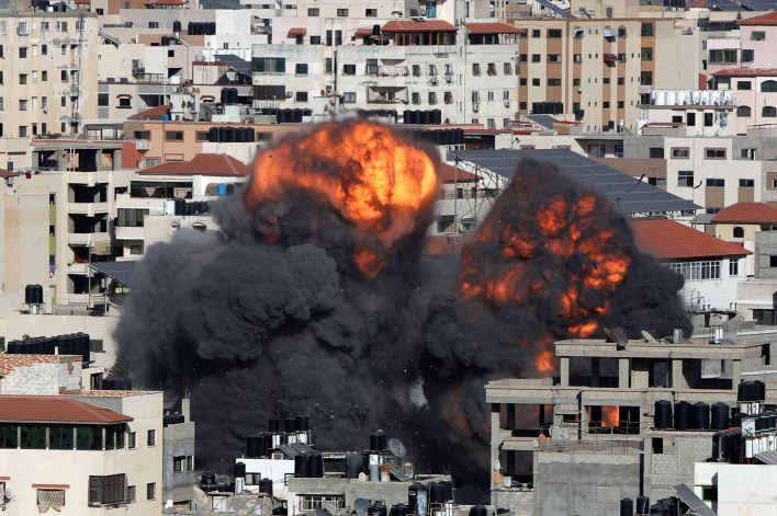 Israel pounds Gaza to curb Palestinian militants but rockets still fly |  Reuters