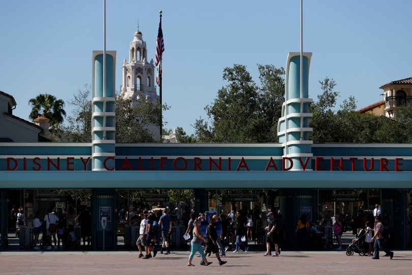 People walk outside Disneyland Park on its reopening day amidst the coronavirus disease (COVID-19) outbreak, in Anaheim, California, U.S., April 30, 2021. REUTERS/Mario Anzuoni