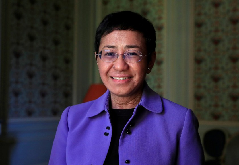 """Maria Ressa, journalist and CEO of the Rappler news website, poses before a news conference to launch a commission to draft an """"International Declaration on Information and Democracy"""" hold by Human rights group Reporters Without Borders in Paris, France, September 11, 2018. REUTERS/Gonzalo Fuentes/File Photo"""
