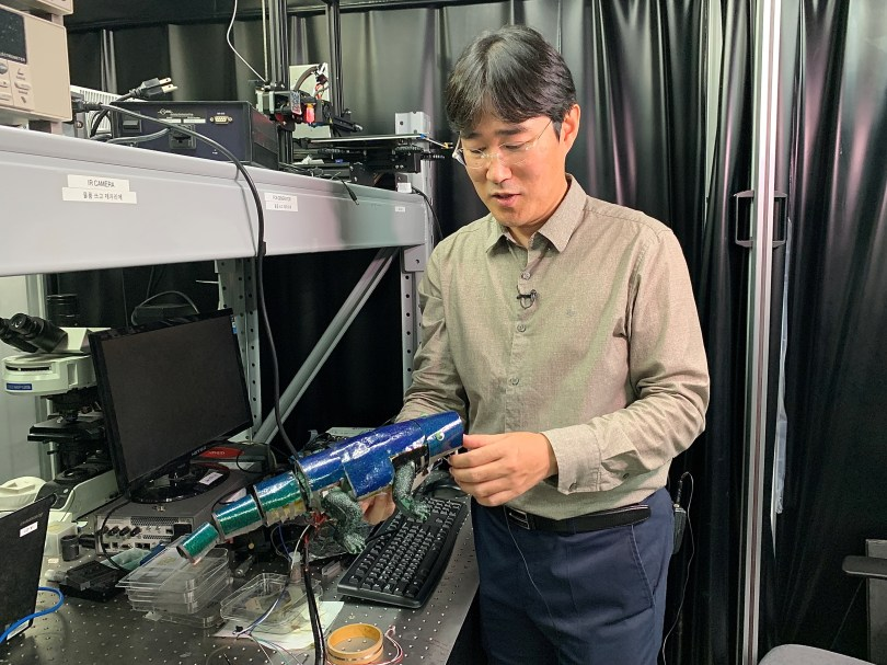 Ko Seung-hwan, mechanical engineering professor at Seoul National University, looks at Chameleon robot covered with artificial skin, in Seoul, South Korea, September 7, 2021. Picture taken September 4, 2021. REUTERS/Minwoo Park
