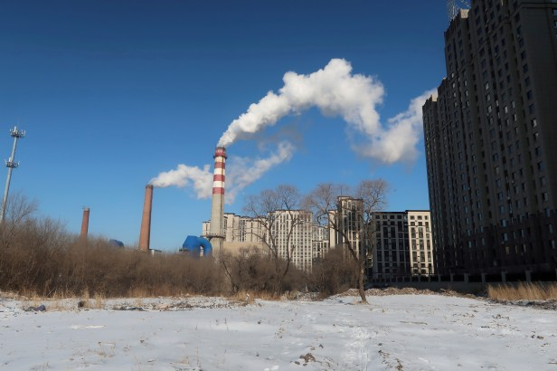 A coal-fired heating complex is seen behind the ground covered by snow in Harbin, Heilongjiang province, China November 15, 2019. Picture taken November 15, 2019.  REUTERS/Muyu Xu/File Photo