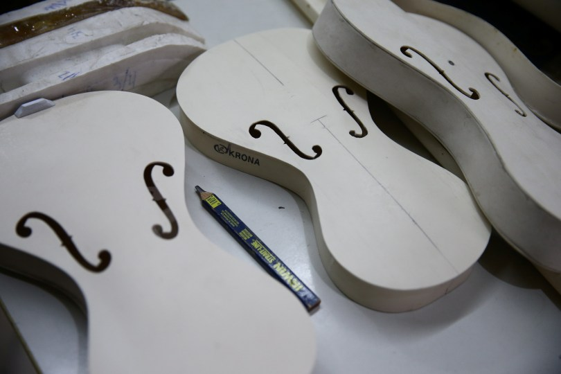 Luthier Ivan Oliveira crafts a violin from PVC piping for Locomotiva Project, a free music school for at-risk children, in Santo Andre, Brazil August 4, 2021. REUTERS/Carla Carniel
