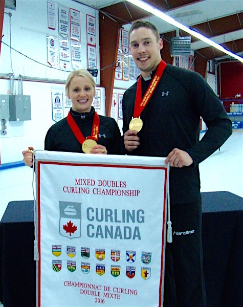 Jocelyn Peterman and Brett Gallant show off their gold medals after the presentation to the 2016 Canadian Mixed Doubles champions at the Nutana Curling Club in Saskatoon, Sask. (Curling Canada/Darlene Danyliw photo)