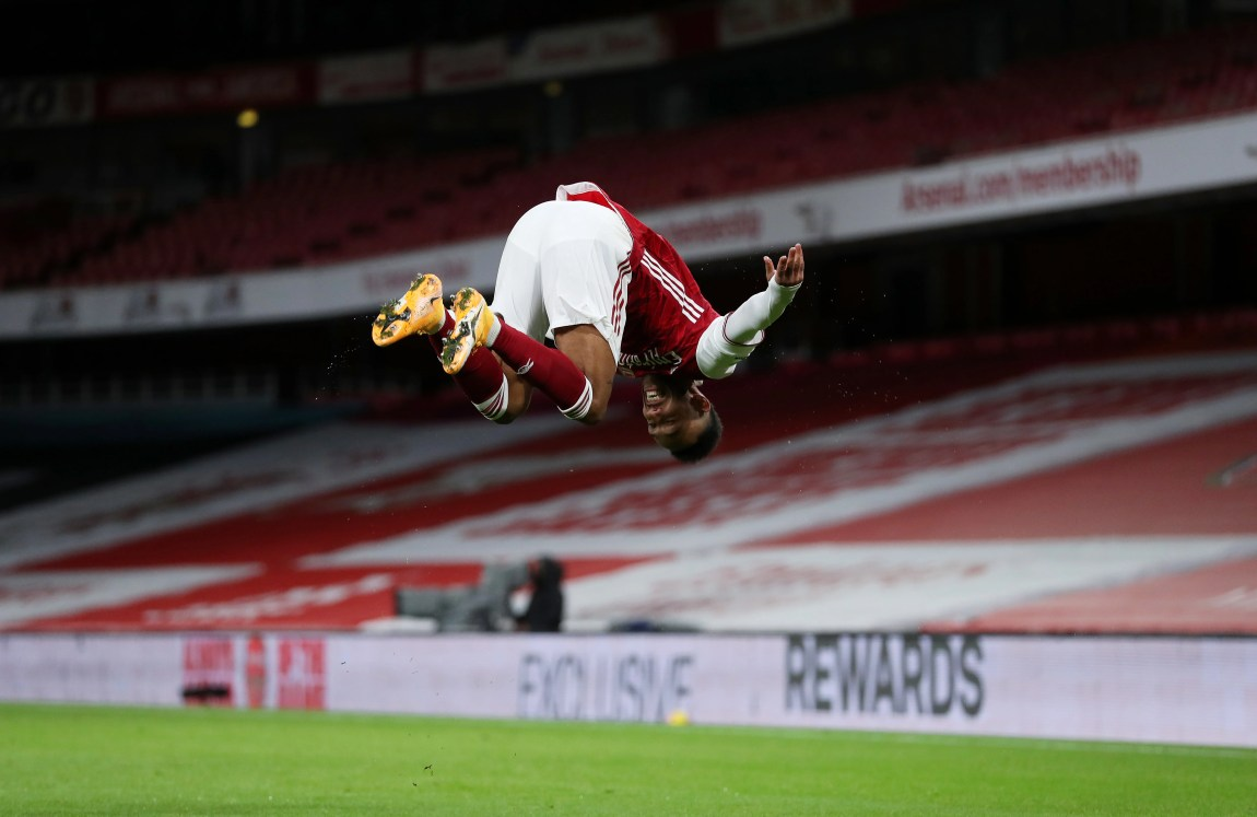 LONDON, ENGLAND - JANUARY 18: Pierre-Emerick Aubameyang of Arsenal celebrates after scoring their team's first goal during the Premier League match between Arsenal and Newcastle United at Emirates Stadium on January 18, 2021 in London, England. Sporting stadiums around England remain under strict restrictions due to the Coronavirus Pandemic as Government social distancing laws prohibit fans inside venues resulting in games being played behind closed doors. (Photo by Catherine Ivill/Getty Images)