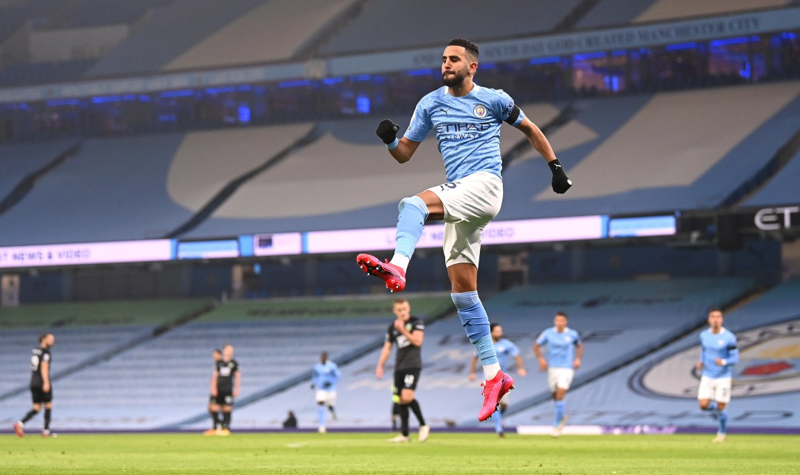 MANCHESTER, ENGLAND - NOVEMBER 28: Riyad Mahrez of Manchester City celebrates after scoring their team's first goal during the Premier League match between Manchester City and Burnley at Etihad Stadium on November 28, 2020 in Manchester, England. Sporting stadiums around the UK remain under strict restrictions due to the Coronavirus Pandemic as Government social distancing laws prohibit fans inside venues resulting in games being played behind closed doors. (Photo by Laurence Griffiths/Getty Images)
