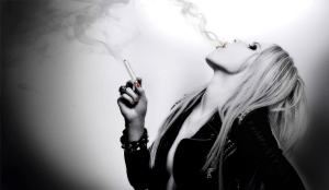 Sexy woman smoking ecigarette