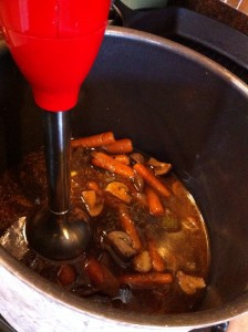 Blending the braising liquid with an immersion blender